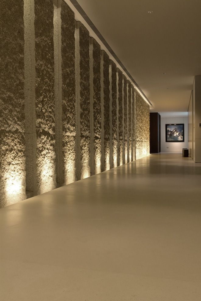 Inviting uplighting frames a corridor at The Museum House. SCDA Interiors design.