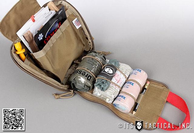 My bad ass ITS ETA trauma kit. Quick clot, Israeli bandage, nasal airway, mojo dart, ace, gloves. + Trauma shears and a CAT tourniquet