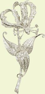 Princess Elizabeth celebrated her 21st birthday abroad, touring southern Africa with her parents and sister. This brooch was one of her birthday presents, a gift from 42,000 children in Southern Rhodesia. The schoolchildren were asked to donate a bit of pocket money each to contribute to the creation of this 301 diamond-strong platinum piece in the shape of a flame lily, a national flower.
