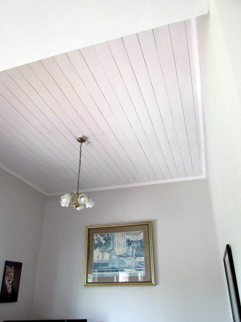 Definite improvement......the grubby mocha/tan walls have been freshened with Resene Half Truffle, timber ceilings and trim in Resene Half Black-White. Lightens it right up and makes it look bigger.