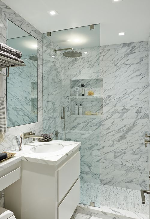 His Bath in a Park Avenue Apartment by Katch I.D. Interiors. Calacutta Gold stone by Artistic Tile. Plumbing by Hans Grohe.