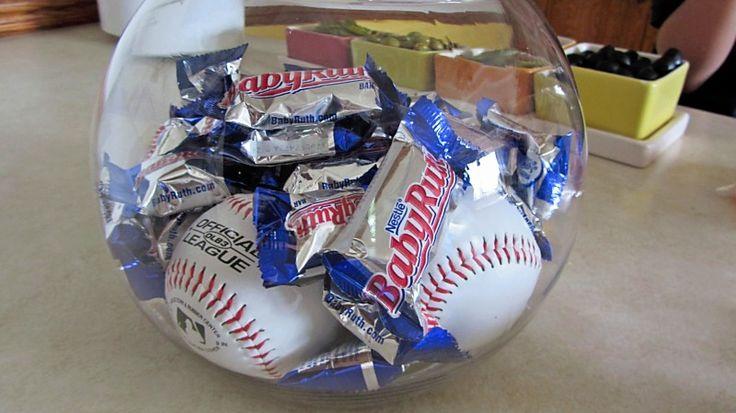 Sports/Baseball party theme - in a fish bowl put baseballs and Baby Ruth candy bars!