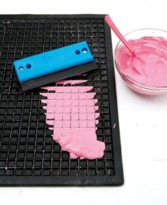 make your own tiles -with wood glue, paint, and plaster, using a rubber car mat as a mold