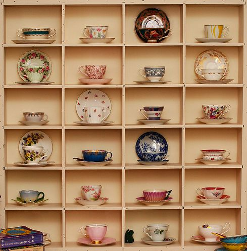 i swear i had this idea long before i found this picture.  i found a shelf like this is my attic started my teacup collection when i realized how perfectly they fit inside.