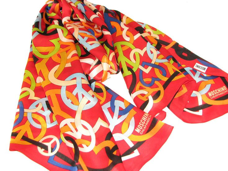 This is a new authentic Moschino silk scarf from the Cheap and Chic collection. Red is the main color of this satin finish silk scarf which is decorated with a design featuring heart and peace signs. Condition :100% Brand NewSize :68 X 26 inchesFabric Content :100% Silk* All prices in US Dollars* Shipping Approximately 7-14 days WORLDWIDE -$20 USD* Payment is by Secure PAYPAL *All DESIGNER items for sale are 100% Original and AuthenticPlease note: As with...