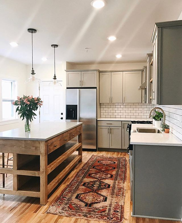 subway tile wood island white countertops and