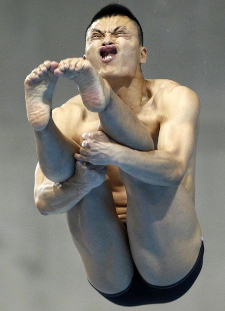 Ken Terauchi of Japan dives in the Men's 3m Springboard preliminary / this is actually the only reason why I am not an Olympic diver.