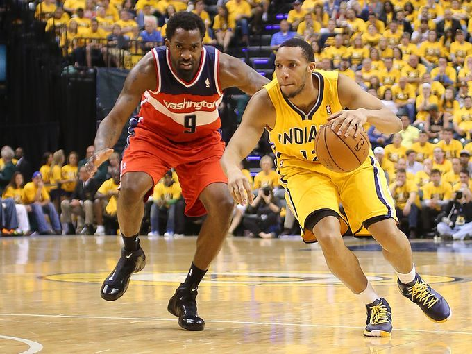 Pacers guard Evan Turner drives the ball past Washington Wizards forward Martell Webster