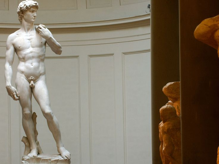 Michelangelo's David is at risk of falling over after an earthquake or roadworks because of fractures in the statue's ankles, researchers have said.