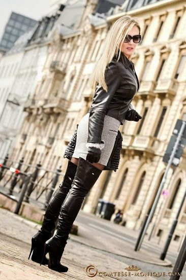 Hot blonde Monique in black and white leather skirt, black leather jacket and thigh boots street style