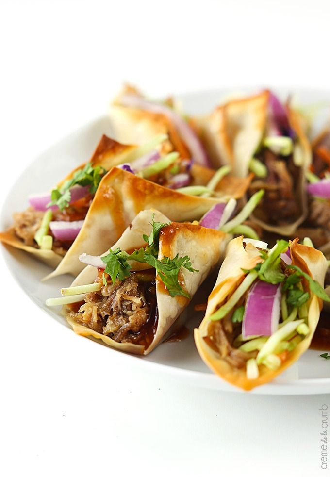 Recipe for Slow Cooker Hawaiian BBQ Pork Wonton Tacos - Sweet n' saucy slow cooked Hawaiian Bbq pork wrapped in wonton wrappers and baked til crispy! All topped with the most amazing sauce! Perfect for a main dish or a party appetizer!
