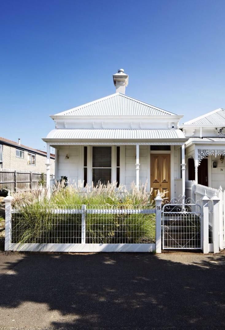 My favorite because anyone can do this with a small cottage - painted all white with a gold colored door, (I would use wood...) vintage fencing & gate, medium height grasses for landscaping, & tall cupola. Darling. Take the tour inside. Most interesting. Designer: Glenn Lamont | Melbourne Design BellaRusticaDesign.com