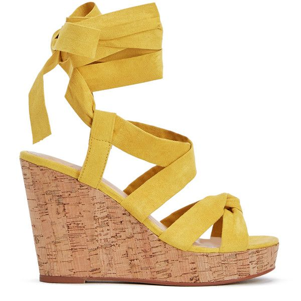 Get into the spring spirit with the cork trend. This JustFab wedge features  soft,
