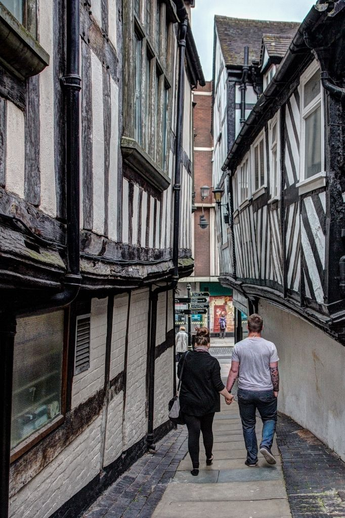 Shrewsbury histroic shutts and passages run between wonky timbered buildings