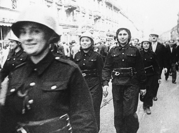 Steel-helmeted, uniformed Polish women march through the streets of Warsaw to aid in defense of their capital after German troops had started their invasion of Poland, on September 16, 1939. (AP Photo) #