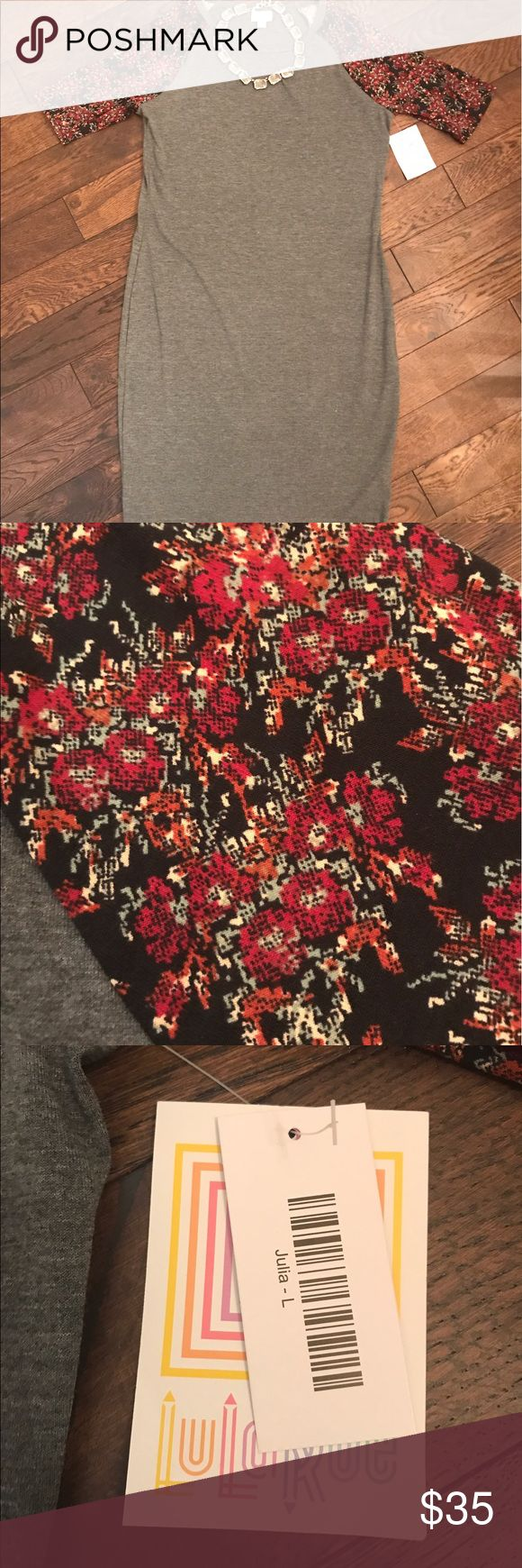 LuLaRoe Julia Gray and Floral Dress NWT (I purchased the wrong size). Dark gray with red Floral raglan sleeves.       The Julia dress is a form fitting, knee- length, knit dress with mid-length sleeves and a high neckline. Its simple silhouette makes the Julia dress a great canvas for layering and accessorizing. This dress is a staple for every season's wardrobe. It is feminine, flattering, and you may not ever want to take it off. LuLaRoe Dresses Midi