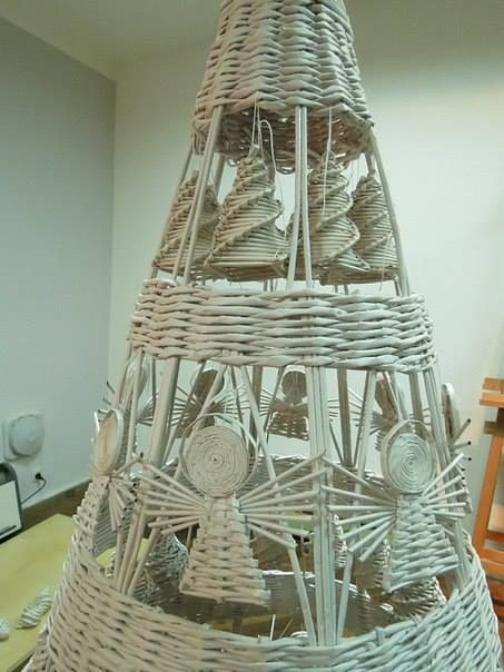 Giant rolled paper reed tree with smaller trees and angels