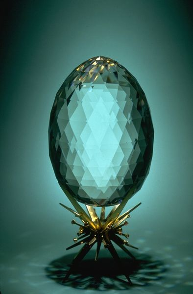 This 7,478 carat faceted (240 facets) quartz egg, originated in Brazil. Under ideal conditions, in spacious cavities or other openings in rock, quartz crystals can grow impressively large, sometimes weighing several tons. Clear colorless quartz, called rock crystal, is the most common gem mineral. Most commonly, rock crystal is used for carvings, chandeliers, and crystal balls.