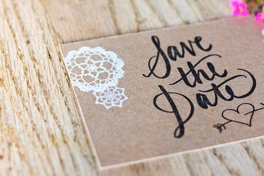 Rustic postcard save the dates with stamped lettering on recycled brown card | The Natural Wedding Company