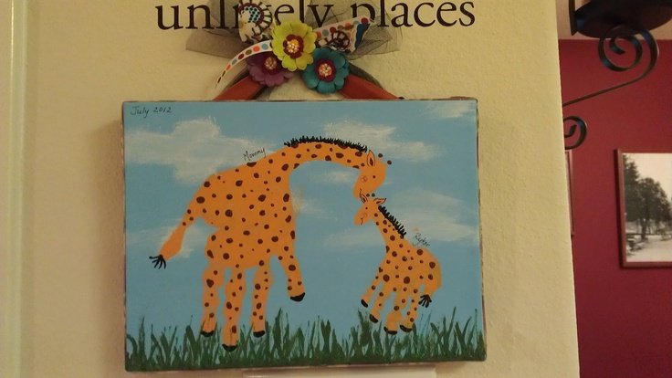 Momma and Baby Giraffes with handprints. #baby craft #toddler craft