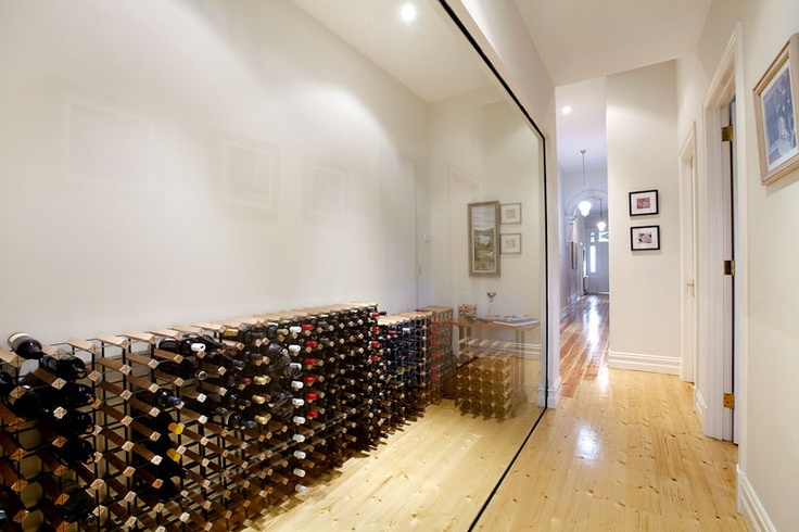 An elegant wine room adding unique character to this hallway