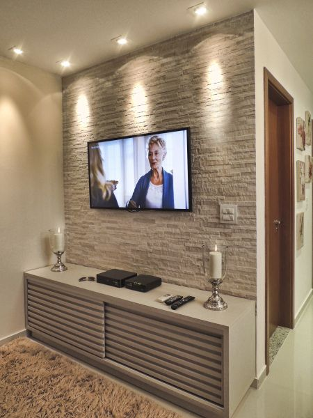 Stone walls make a gorgeous feature in the home. I love this colour of stone, adds depth and texture to the room without making the room look smaller. I would have a softer lighting effect around the tv also