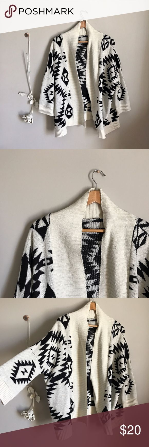 Aztec print cardigan Super cute cream-color and black Aztec print cardigan. The tags are gone but it fits like a medium. In perfect condition :) Sweaters Cardigans
