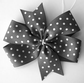 Pinwheel bow tutorial, She has a bunch of other tutorial links too for just about any bow you could want.  Great Blog!