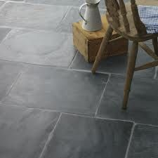 Dark grey flagstone tile for kitchen. I like the darker tone and irregular surface.