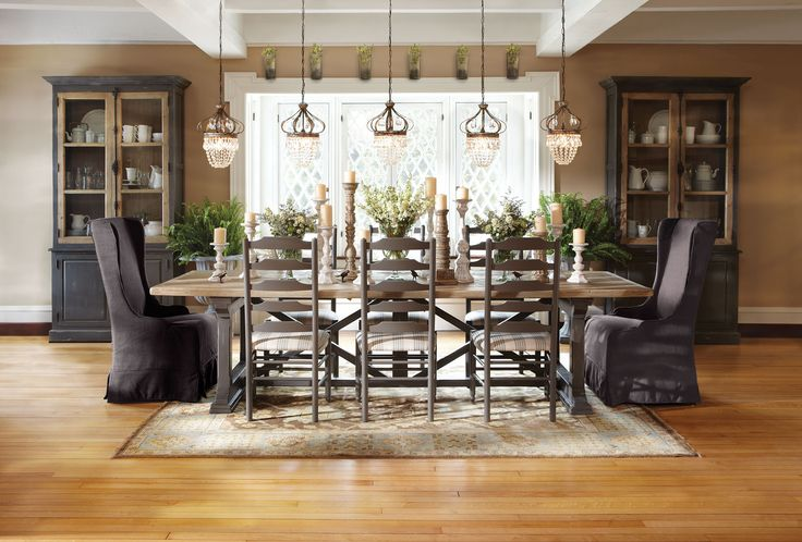 Arhaus: rustic table, ladder back chairs, upholstered end chairs, multiple crystal chandeliers.