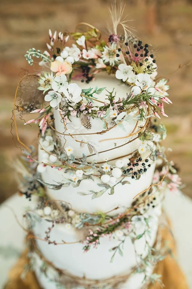 Wedding cake wrapped in flowers - So beautiful.  A romantic and whimsical wedding cake. Wedding inspiration - Rustic wedding ideas.