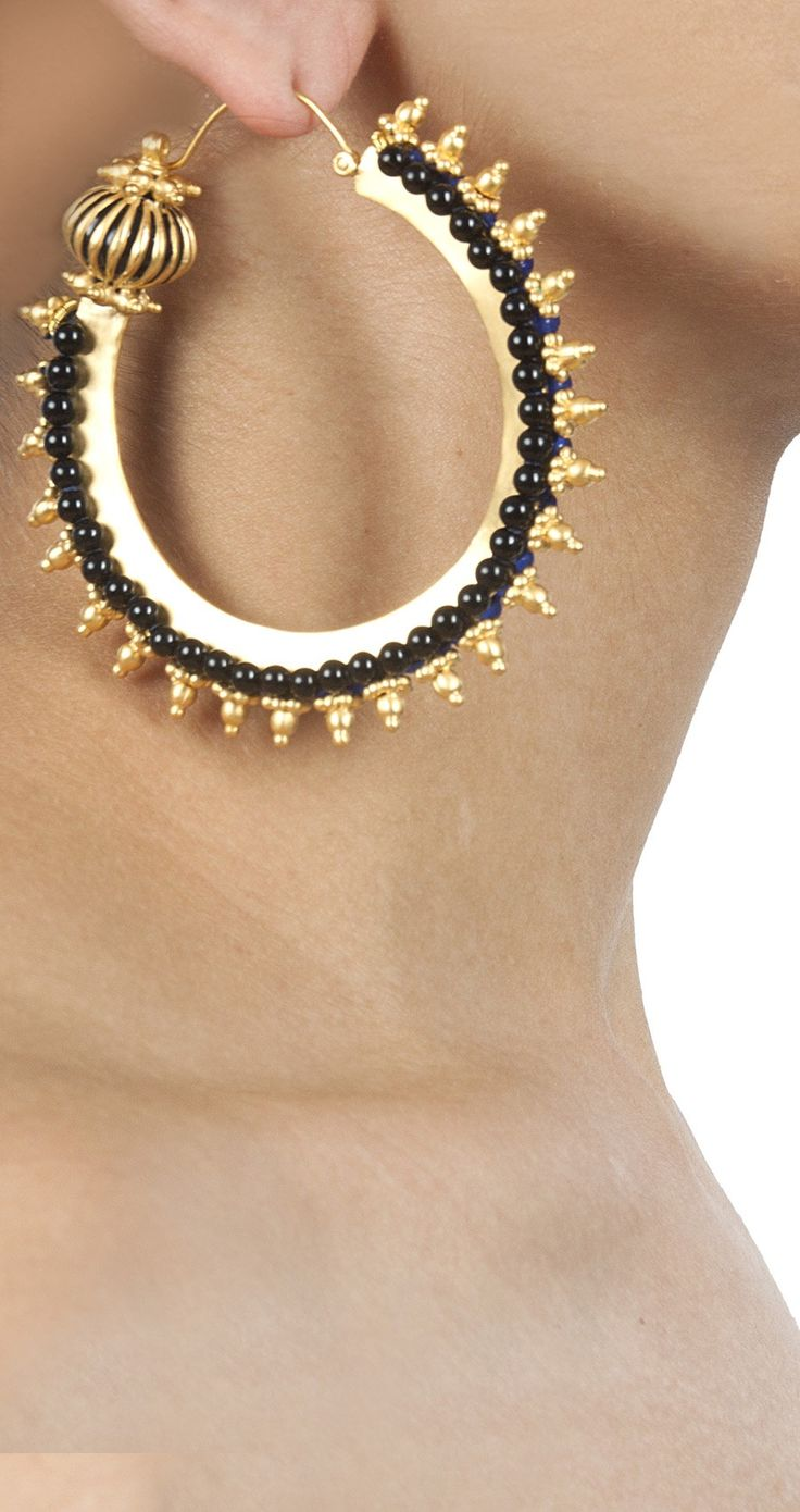 Get inspired by this Leda earrings by Manish Arora for Amrapali.