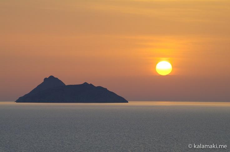 Kalamaki, Crete, Kreta. Sunset behind Paximadia islands. Sonnenuntergang hinter den Paximadia-Inseln.
