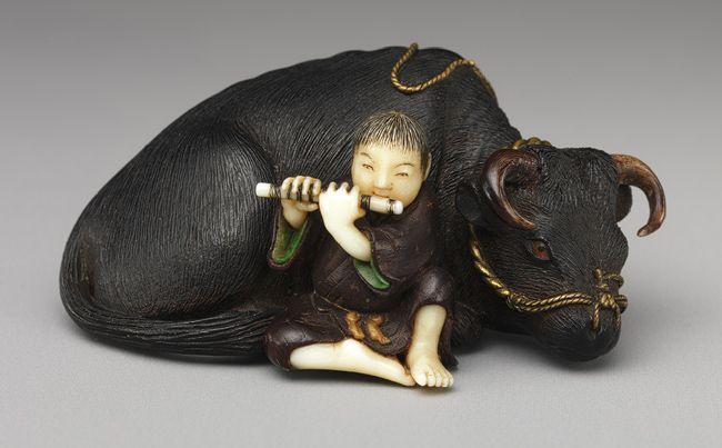 Netsuke: Ox with boy playing flute, 19th century  Japanese  Wood, ivory, metal