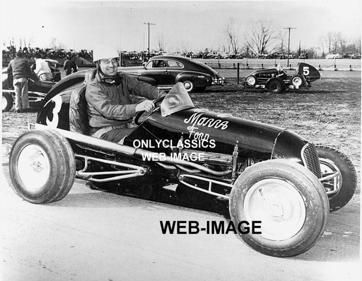 Al pillion auto racing vintage midget car on trailer photo