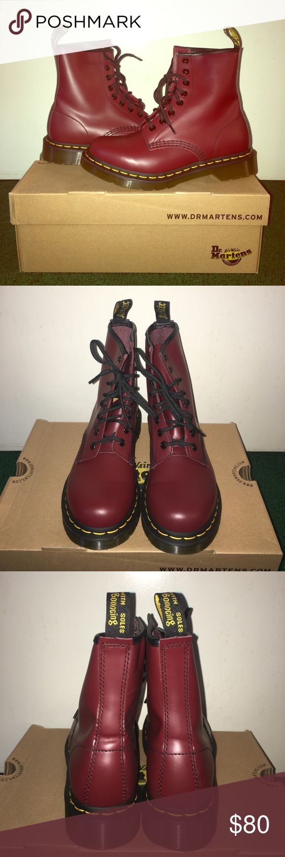 Dr. Martens Cherry Red Boots Women's 1460 W Dr. Martens. 8-eye, cherry red (burgundy). Size 6. I'm normally a 6.5 & these fit me comfortably. Comes with box, original insole inserts & additional yellow laces. Only been worn once or twice. Dr. Martens Shoes Combat & Moto Boots