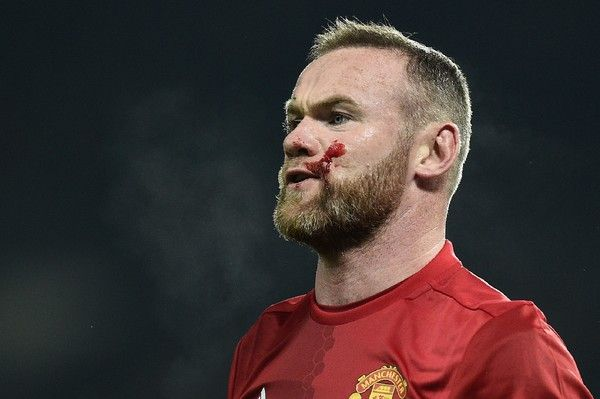 Blood covers the cheek of Manchester United's English striker Wayne Rooney as he remonstrates with referee Mike Jones after clashing with West Ham United's New Zealand defender Winston Reid during the EFL (English Football League) Cup quarter-final football match between Manchester United and West Ham United at Old Trafford in Manchester, north west England, on November 30, 2016.  / AFP / Oli SCARFF / RESTRICTED TO EDITORIAL USE. No use with unauthorized audio, video, data, fixture lists…