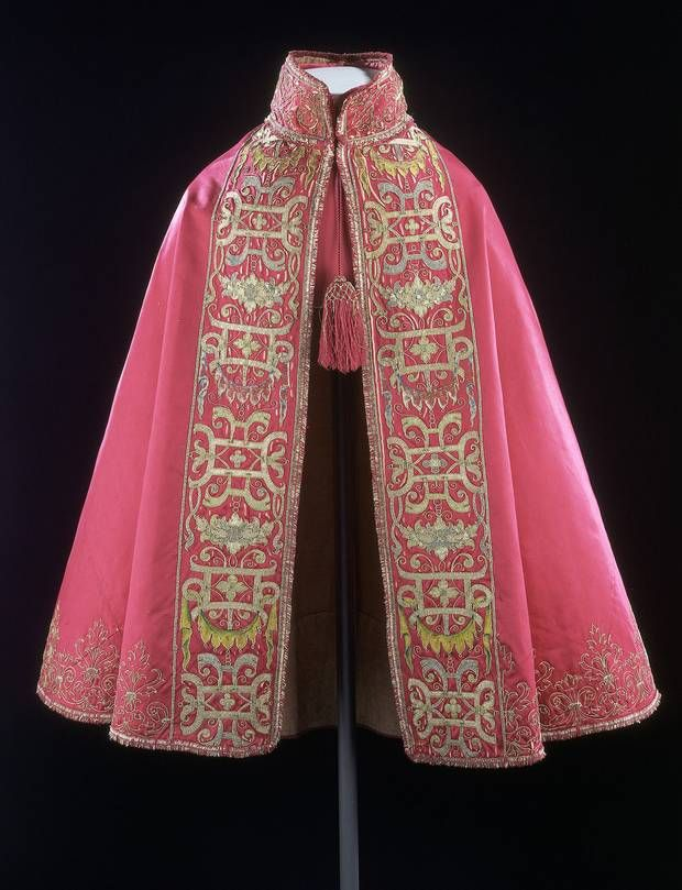 1580-1600 French silk cloak at the Victoria and Albert Museum, London - I am fascinated with the wide band of embroidery here, as well as the colour. It all looks very rich, even if the red has faded a bit to pink over the years.