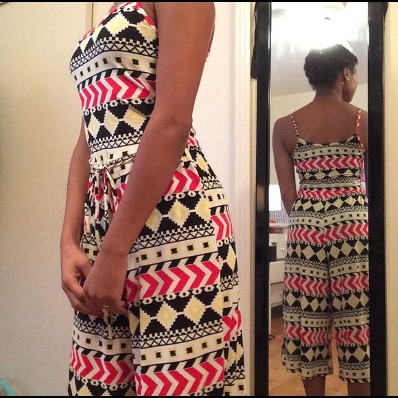 Calf skimming Aztec jumpsuit adjustable straps Aztec print! Adjustable spaghetti straps! Beautiful fit! You can through on a blazer and be work appropriate in a stitch! Never worn without tags. Any questions, don't hesitate to ask! Dresses