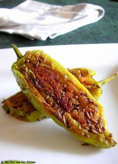 Aloo Stuffed Chilli Peppers | Bharwa Mirch 8-10 long thick light Green chillies/Poblano peppers(bajji variety with less spice) 4 Potatoes,boiled and peeled 2 tbsp besan 1 Onion,finely chopped 2-3 tbsp chopped Coriander 1/2 tsp Red chili powder 1/2 tsp Garam masala 1/2 tsp Coriander powder 1/2 tsp Amchur powder 1 tsp Lemon juice 1 tsp Saunf 1 tsp Jeera 1/2 tsp Ajwain a pinch of hing Oil to shallow fry Salt to taste