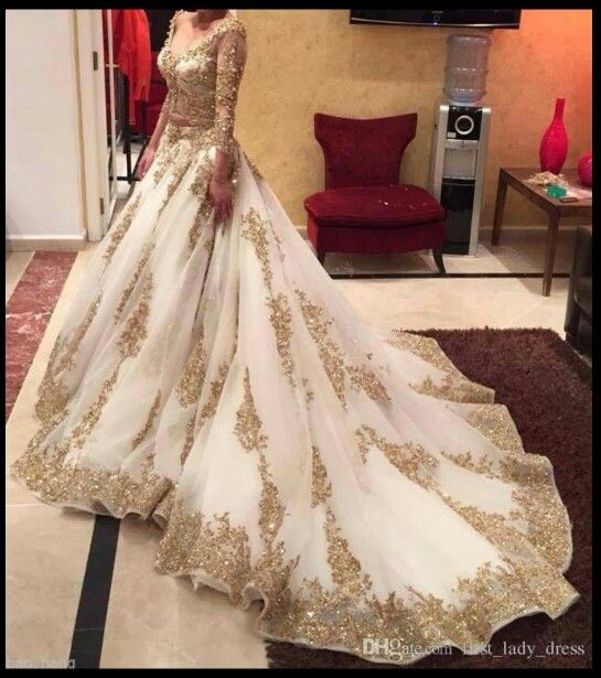 Saudi Arabian wedding dress.. Gold and white..