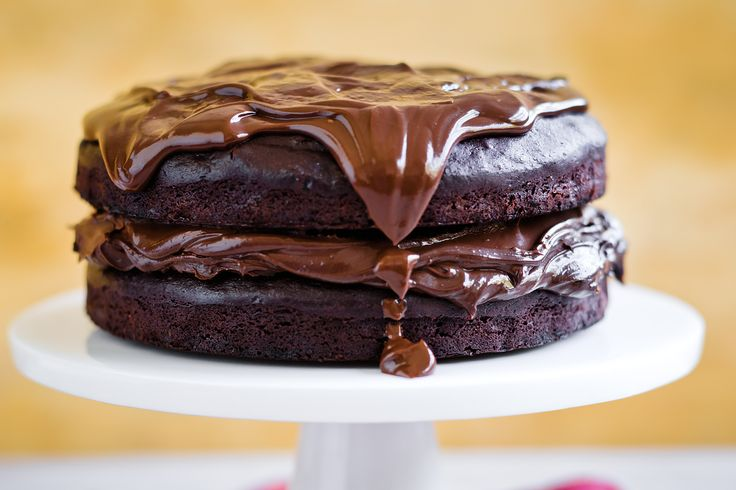 This chocolate cake can be semi-assembled and refrigerated up to 3 hours in advance. Pour over the room temperature ganache to serve.
