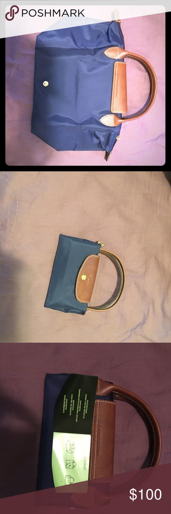 LONGCHAMP Le Pliage bag BRAND NEW Never been used LONG CHAMP bag in navy color. Authentic bag. 9 1/4 x 8 1/4 x 5 1/2 size. Longchamp Bags Totes