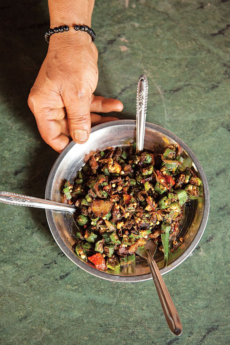 Crisp-fried okra is flavored with garam masala, coriander, chiles, and onions in this quick north Indian recipe.