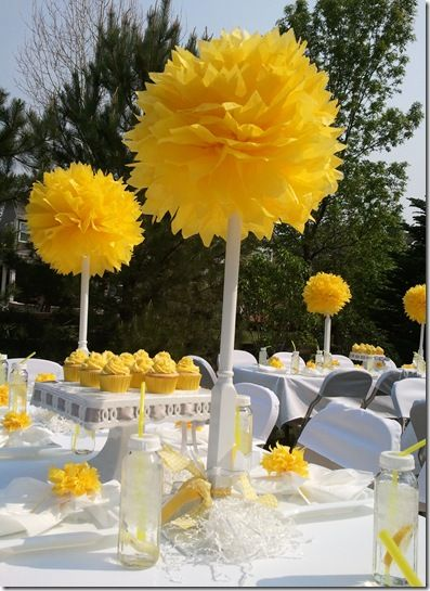 I actually had this idea for tissue paper yellow flowers but smaller placed on the table tops to give the center piece some volume.