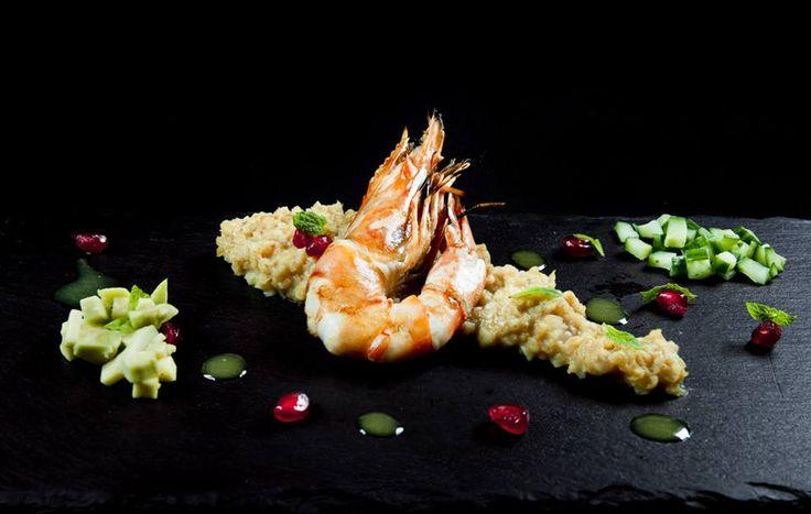 Xinohontro with shrimp, avocado, pomegranate, cucumber, fresh mint & citrus dressing. NU MODERN GREEK CUISINE CRETE PAPAROUNA WINE RESTAURANT & COCKTAIL BAR