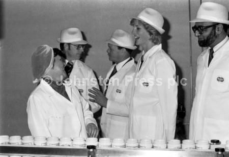 Princess Diana jokes with female employee Helen Campbell at the Keillers factory during her visit to Dundee in September 1983.