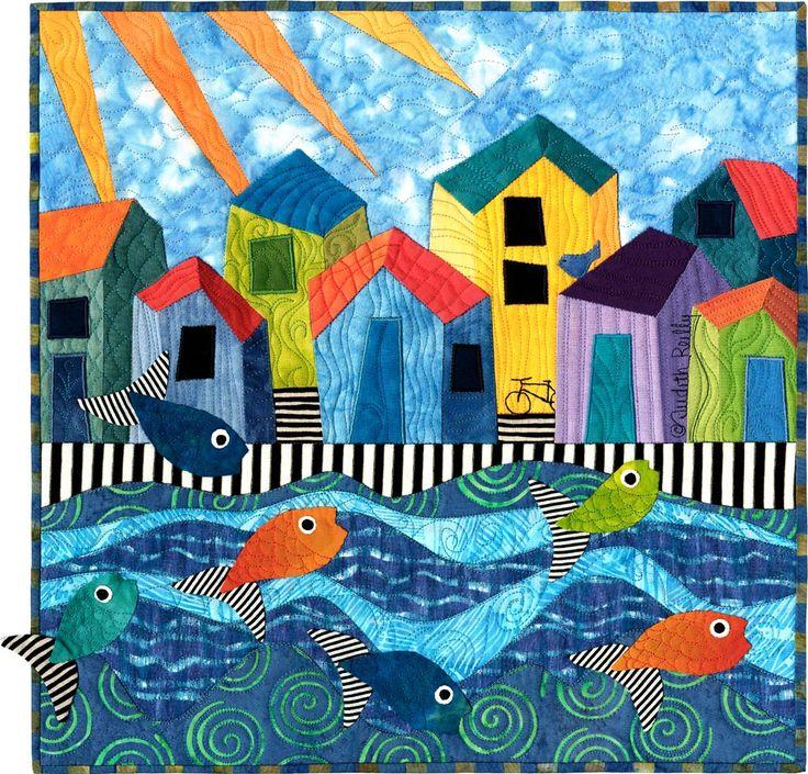 ©2007 Judith Reilly:Fishing Village: 15″ x 15″ fabric and thread original artwork. Machine pieced and appliquéd; machine quilted. 100% cotton fabrics.