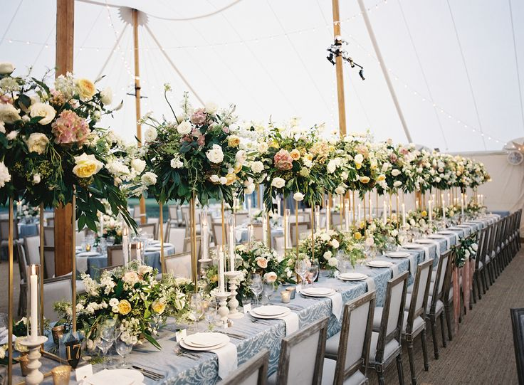 An estate table flooded with candlelight and soft garden blooms was the focal highlight of the soaring Sperry tent. photo: @tecpetaja design: @calderclark venue: #fenwickhall flowers: @blossoms_events tent: @sperrytentssoutheast lighting: @technicalevent #lowcountry #charleston #charlestonwedding #southernwedding #plantationwedding #destinationwedding #tentedwedding #destinationplanner #luxury #luxurywedding #reception #jewishwedding #arbor #green #white #whitebouquet #chuppah