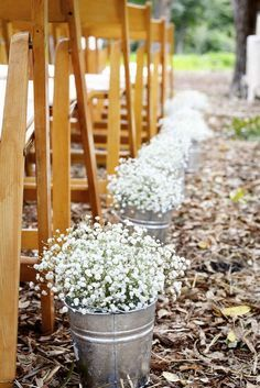 Tin Buckets Filled with Baby's Breath Lining the Ceremony Aisle